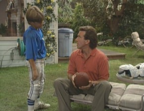 Tim has a football talk with middle son Randy (Jonathan Taylor Thomas).