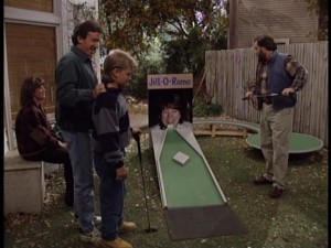Tim and company find good use for Jill's unflattering driver's license blow-up with some homemade backyard mini golf.