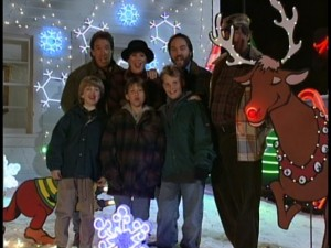 The Taylors (plus Al and Wilson) wish you a Merry Christmas with some grunt-laced caroling.