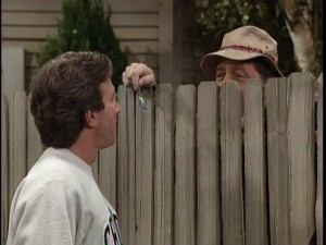 Tim looks for some over-the-fence wisdom from his enigmatic neighbor, Wilson.