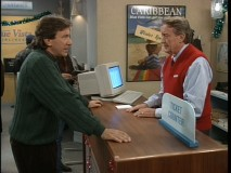 """'Twas the Flight Before Christmas"" and this airport clerk (guest Tom Poston) isn't much help."