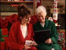 With matching green and red robes, Jill and her Mom (Polly Holliday) overcome their problems to enjoy Christmas together.
