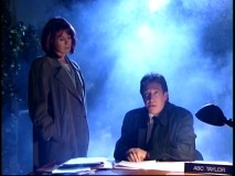 Scully and Mulder of The X-Files are spoofed in Tim's nightmare, in which he plays trenchcoat-wearing ABC Taylor amidst foggy extraterrestrial intrigue.