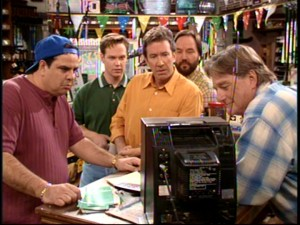 Benny, Marty, Tim, Al, and Harry gather around a TV at the hardware store to watch Jill badmouth her husband.