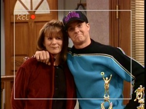 "Eldest son Brad Taylor (Zachery Ty Bryan) attempts to impress colleges by mentioning his relationship with his ""main mom"" in a video resume filmed by the sparsely-seen Mark."