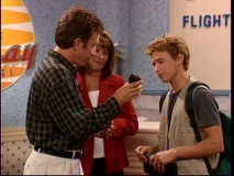 Three years pre-9/11, the Taylor parents are able to see Randy (Jonathan Taylor Thomas) off at the gate of his flight to Costa Rica, with Tim giving him a handheld tape recorder with nuggets of wisdom.