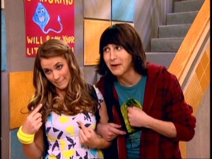 Lilly (Emily Osment) and Oliver (Mitchel Musso) are relieved not to worry about junior prom invitations. Now a couple, they're obviously going together.