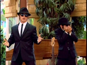 "Believe it or not, that's not Aykroyd and Belushi but Jason Earles and Moises Arias, whose Blues Brothers act is one of several short musical performances they give as the minstrels of ""He Could Be the One."""