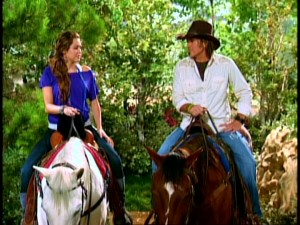 "Does this shot of Hannah and her Dad riding horses from near the end of the series finale hint at what's to come for ""Hannah Montana"" in a Season 4?"