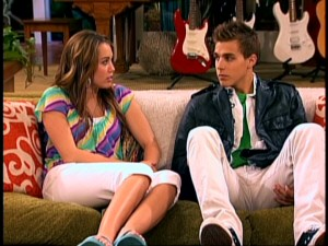 "Miley talks to Jake Ryan (Cody Lindley), now a short-haired brunette, in the alternate ending to love triangle episode ""He Could Be the One."""