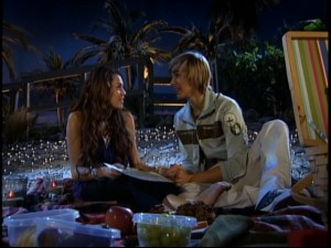 "Jake Ryan (Cody Linley) confides in Miley Stewart on the beach in ""Achey Jakey Heart."""