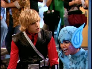 Posing as Mikayla, Miley accepts a phone call while filming a scene with Jake (Cody Linley), much to his chagrin.