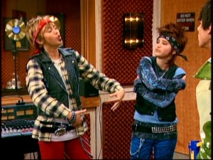 Miley and Lilly pick up a lesson or two from Mulan and cross dress in an effort to split the Jonas Brothers apart from Robby Ray. No, it doesn't make sense in the context of the episode, either.