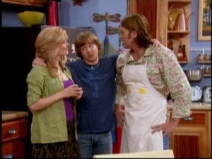 Jackson (Jason Earles) tries desperately to keep his dad (Billy Ray Cyrus) and teacher (guest Erin Matthews) from arguing.