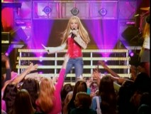 "Hannah Montana performs to adoring fans in the bonus ""music video."""