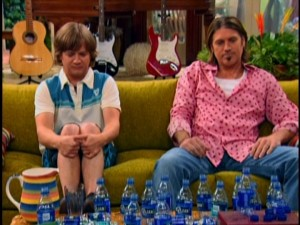 Father and son try to hold their water after dozens of water bottles. Just an ordinary day in Billy Ray Cyrus' fictional home...