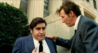 After swiping a confidential file, palpitating Dick Suskind (Alfred Molina) needs some calming down from his partner in crime.