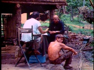 "Francis Ford Coppola sits and talks about the part of Colonel Kurtz with a bald Marlon Brando, who has shown up overweight and not having read Joseph Conrad's ""Heart of Darkness."""