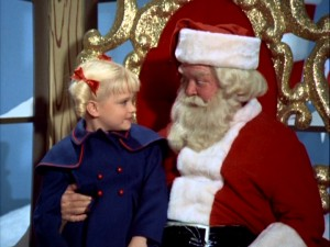 "Cindy Brady (Susan Olsen) sits on Santa's lap and asks for something unusual in ""The Voice of Christmas."""