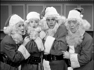 "Ethel, Lucy, Ricky, and Fred are four Santa Clauses surprised by the just-vanished fifth at the end of the ""I Love Lucy Christmas Show."""