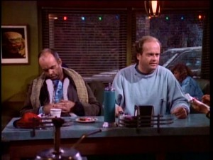 Frasier (Kelsey Grammer) gets Christmas dinner looking like his impoverished company at Lou's pitiful diner.