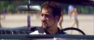 Joey Fatone's character Buddy plays Renato's best friend who sits in his car even at the beach for reasons that are later made clear.