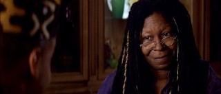 Yes, that's none other than Oscar winner Whoopi Goldberg. What's she doing in the land of direct-to-video fare, aside from adding a bit of heart?