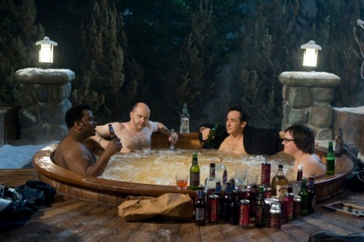 Nick (Craig Robinson), Lou (Rob Corddry), Adam (Joh Cusack), and Jacob (Clark Duke) take a soak in what they soon learn is a hot tub time machine.