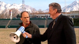 "Every so often, the mountains of Utah appear in the background of each film. One such instance is this ""Hatching Pete"" scene in which Principal Daly (Edward Herrmann) holds a loudspeaker up for Coach Mackey (Brian Stepanek) to make an announcement."