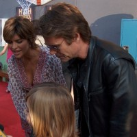 "Lisa Rinna, hostess of Soapnet's ""Soap Talk"", with actor-husband, Harry Hamlin and their two daughters."