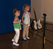 Smaller kids were content to merely sing and dance in the midst of musical instruments.