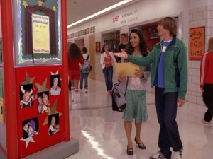 Troy (Zac Efron) presents a gift to newcomer Gabriella (Vanessa Anne Hudgens): a red column.