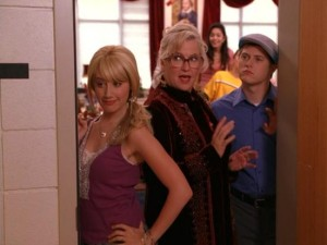 The bad guys (Ashley Tisdale, Alyson Reed, and Lucas Grabeel) prepare for an earthquake by standing in a doorway.