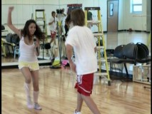 "The remixed ""Breaking Free"" music video finds Efron and Hudgens having fun dancing in the studio."