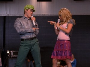 Bro and sis Ryan (Lucas Grabeel) and Sharpay (Ashley Tisdale) ham it up on stage.