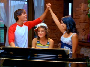 Troy (Zac Efron) and Gabriella (Vanessa Hudgens) somehow already know the words to the song Kelsi (Olesya Rulin) just wrote them.