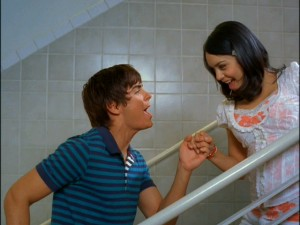 Zac Efron and Vanessa Ann Hudgens perform this backwards stair-walking stunt all on their own.