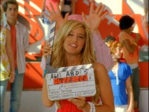 Ashley Tisdale kicks off the disc's bloopers reel with Lucas Grabeel throwing up moose antlers behind her.
