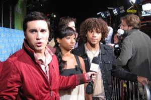 From right to left: Corbin Bleu, Monique Coleman, and this guy all look in different directions.
