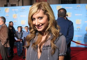 Ashley Tisdale gives a nice smile while posing for this exclusive UltimateDisney.com photo.