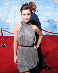 "Disney Channel movie veteran Olesya Rulin (Kelsi in ""High School Musical"" 1 and 2) poses for a red carpet photo with hand on hip."