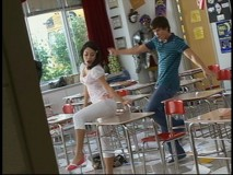 "A sneak peek at a new scene from ""High School Musical 2"": Zac Efron and Vanessa Ann Hudgens dance in a classroom as Troy Bolton and Gabriella Montez."