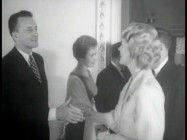 "George C. Scott shakes hands with a guest at the premiere screening of ""The Hustler"", as seen in recycled featurette ""The Inside Story."""