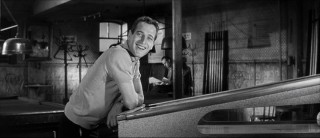 "Paul Newman smiles widely as pool shark Fast Eddie Felson in ""The Hustler."""