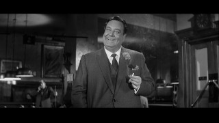 "Minnesota Fats (""The Honeymooners"" star Jackie Gleason) chuckles through smoke, as seen in the 2002 Special Edition DVD. (Click to view in full 720 x 480.)"