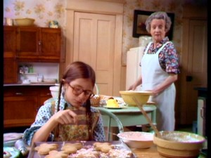 Addie and Grandma (Mildred Natwick) talk turkey while baking gingerbread cookies.