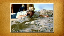 Steven Spielberg plays Gulliver's Travels in a still from the gallery.