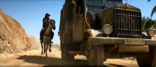 Indy chases after the Nazi vehicles on horseback, in a nod to classic adventure serials.