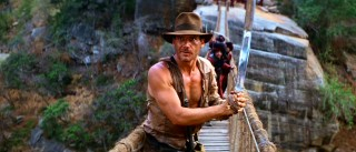 With opposition clearly approaching from both directions of this rope bridge, all Indiana Jones can do is wield a sword, flex, and look tough. Juggling the three is sure to make the short wait feel even shorter.