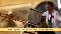 Indy's smug getaway smile shares the screen with a vacant mine car in the filtered animated main menu.